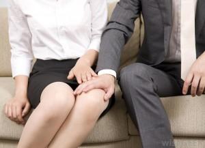man-touching-womans-knee